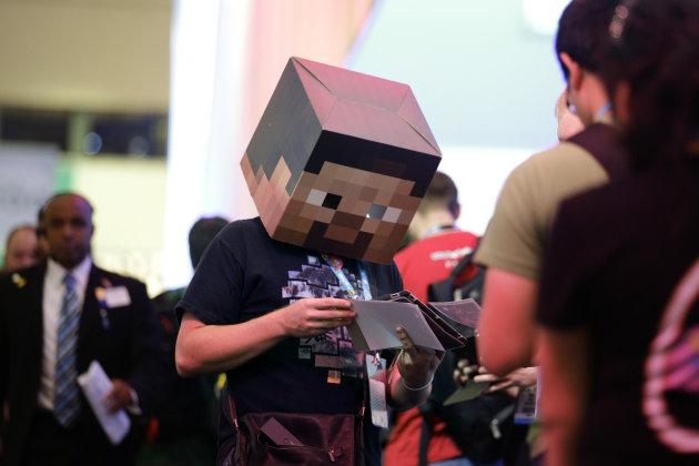 A fan wearing the head of Minecraft's protagonist, Steve
